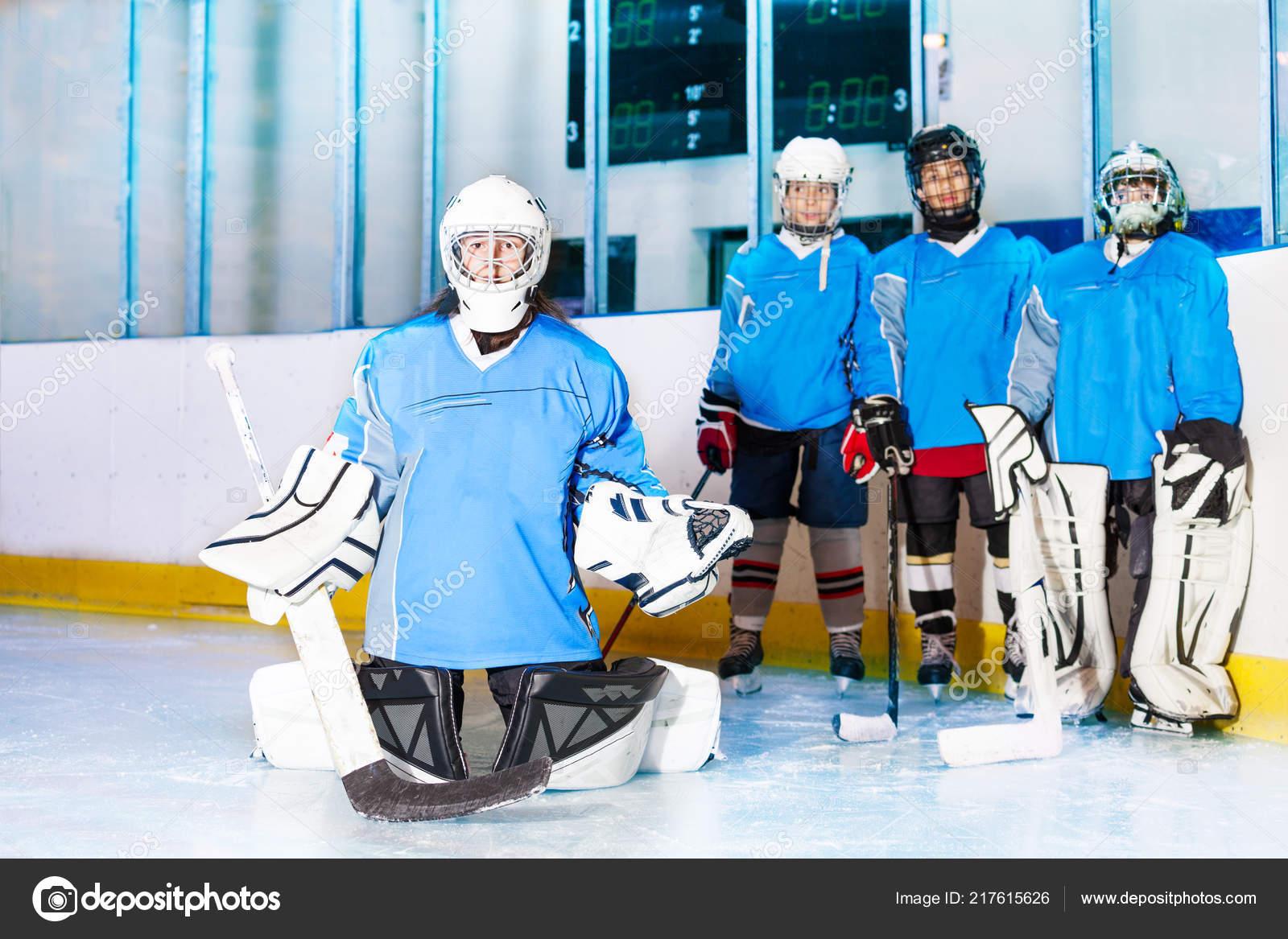 Portrait Teenage Girl Wearing Hockey Goalie Uniform Standing