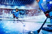 Fotografie Portrait of ice hockey player passing the puck to teammate during the game at stadium