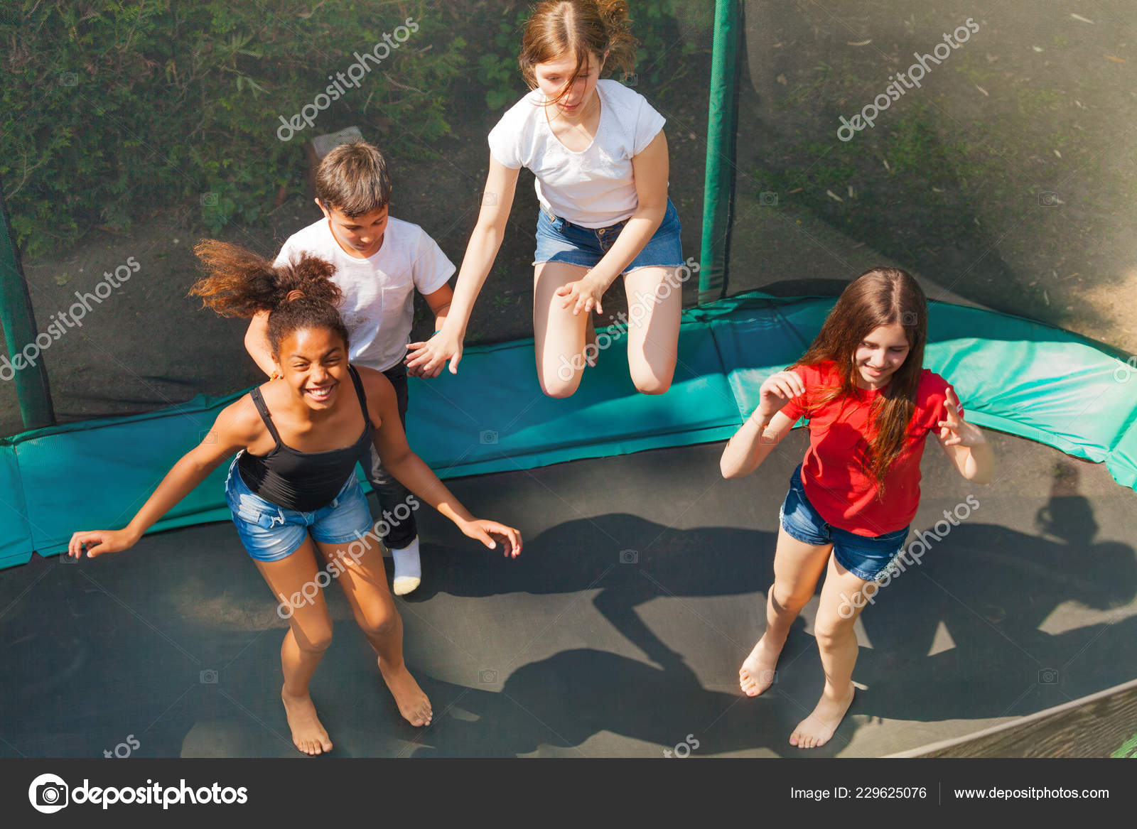 Top View Four Friends Teenage Girls Boys Bouncing Outdoor Trampoline —  Stock Photo