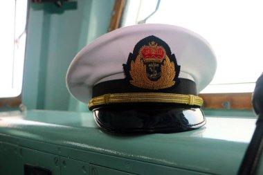 Pelabuhan Klang,  Malaysia - April 13,2019: Malaysian Royal Navy office's hat in KD Jebat command bridge during 85th Malaysian Royal Navy open day in Pelabuhan Klang, Selangor.