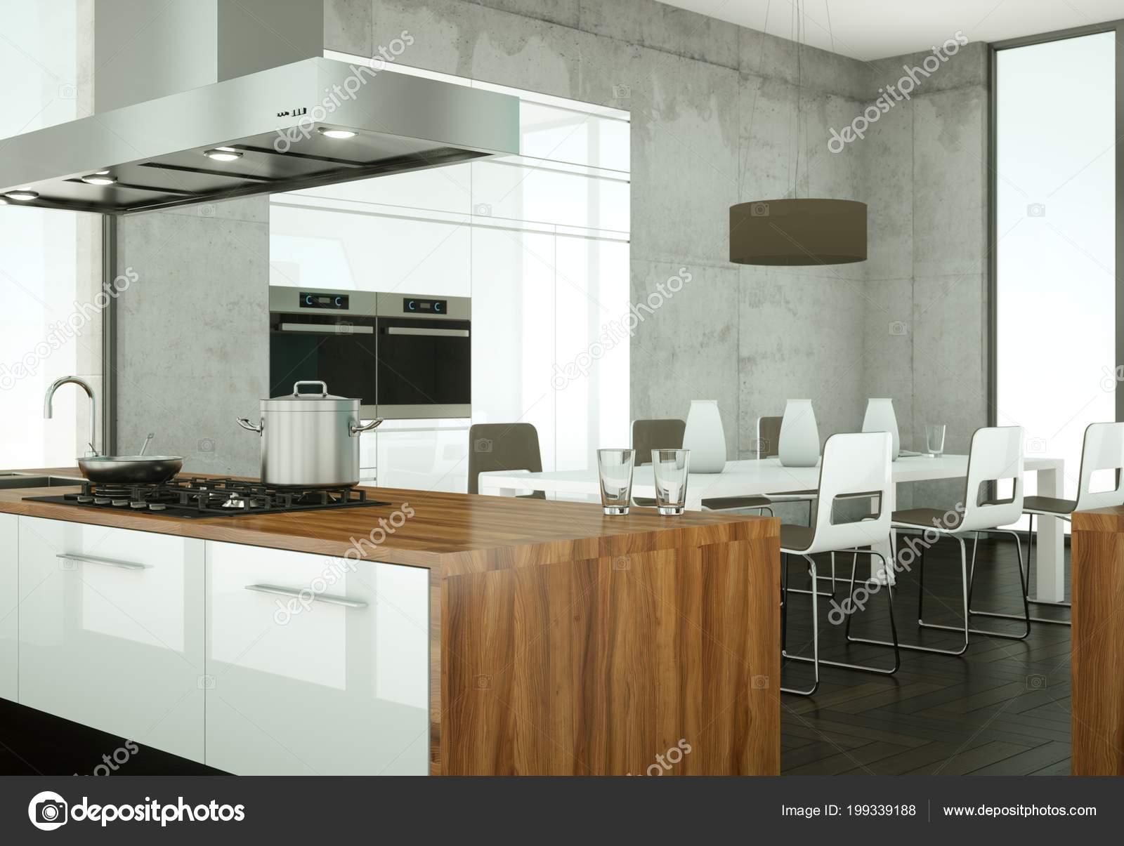 Helle moderne küche in einem raum mit betonmauer u stockfoto