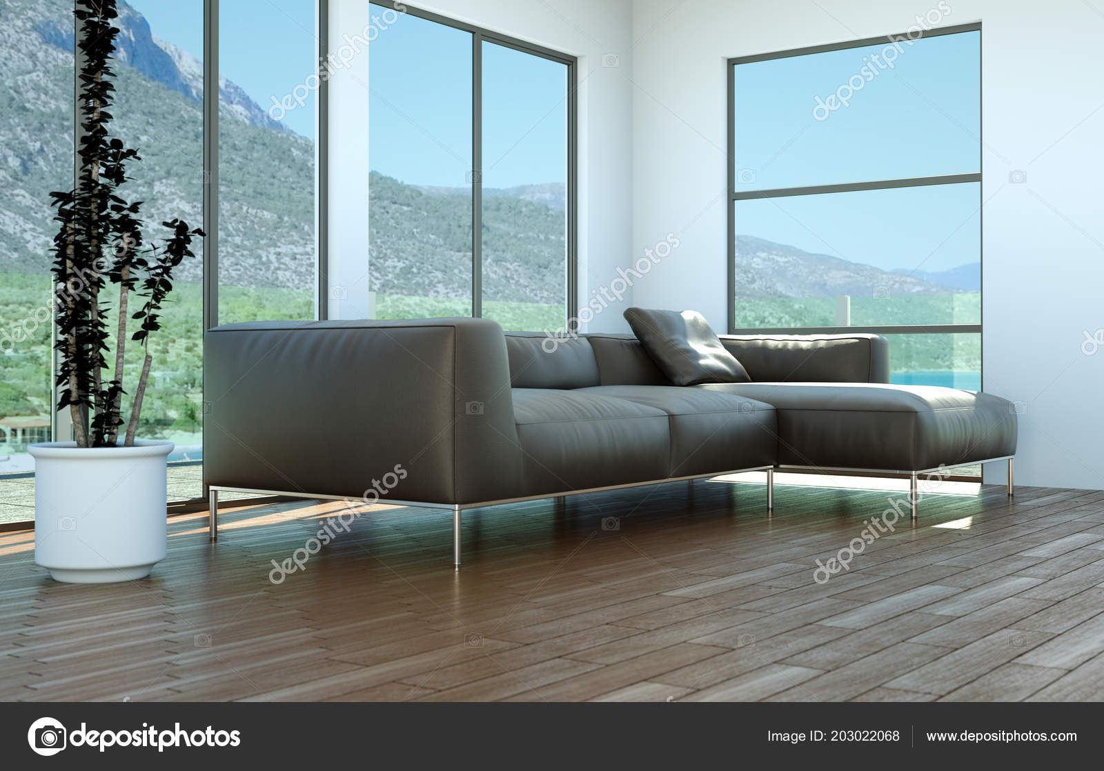 Bright Room With Leather Sofa In Front Of A Window Stock Photo
