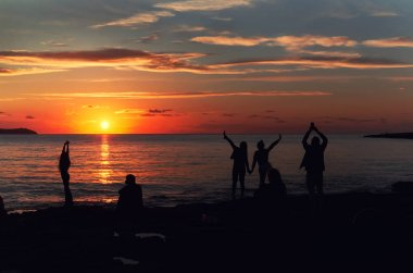 Silhouette of a people during the sunset at Cafe Del Mar. Ibiza Island. Balearic Islands. Spain