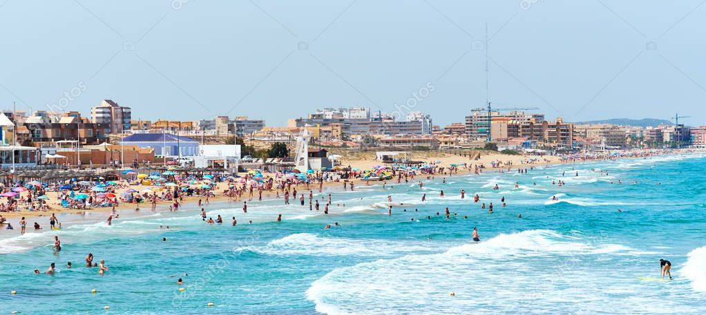 La Mata, Spain - June 25, 2018: Crowd of people on the beach of La Mata at summer. Costa Blanca. Spain