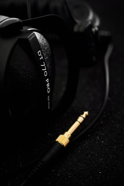 Beyerdynamic circumaural head phones over black background, for mixing, mastering, monitoring (closed) close up, nobody. Most popular and professional studio headphones market leader. Made in Germany