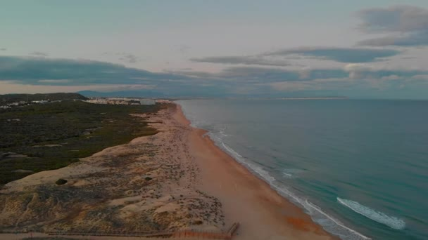 Picturesque scenery aerial drone view landscape, calm blue Mediterranean Sea fluffy clouds at sunset evening sky, sandy coastline of La Mata, Torrevieja, Costa Blanca, Spain