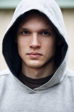 Portrait of a man in a hood