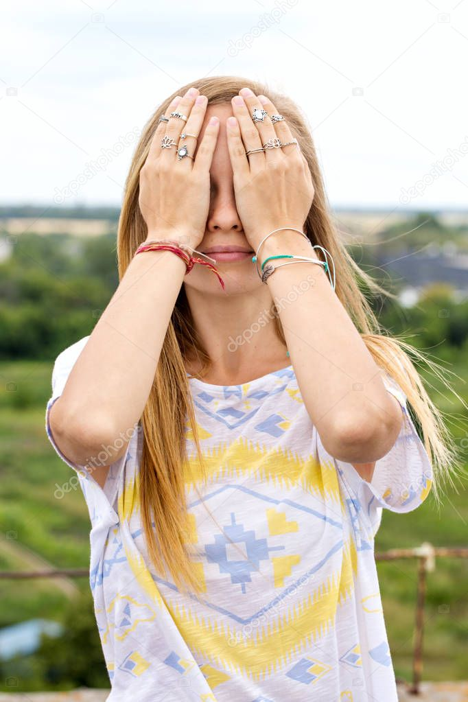 girl with eyes closed hands