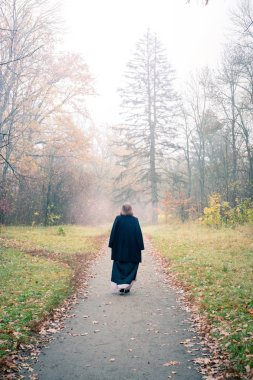 Woman goes into the fog
