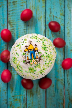 Easter cake with a church on a blue background