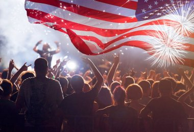 Crowd of people celebrating Independence Day. United States of America USA flag with fireworks background for 4th of July.