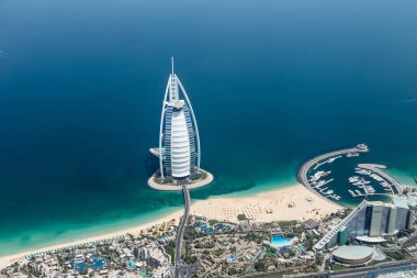DUBAI, UAE - MAY 28: Burj Al Arab hotel on May 28, 2018 in Dubai, UAE. Burj Al Arab is a luxury unofficial 7star hotel built on an artificial island in front of Jumeirah beach. View from hydroplane.