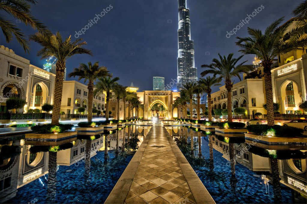 Dubai, United Arab Emirates - May 28 - Night view of Burj Khalifa - the highest building in the world - and lights reflection on the water.