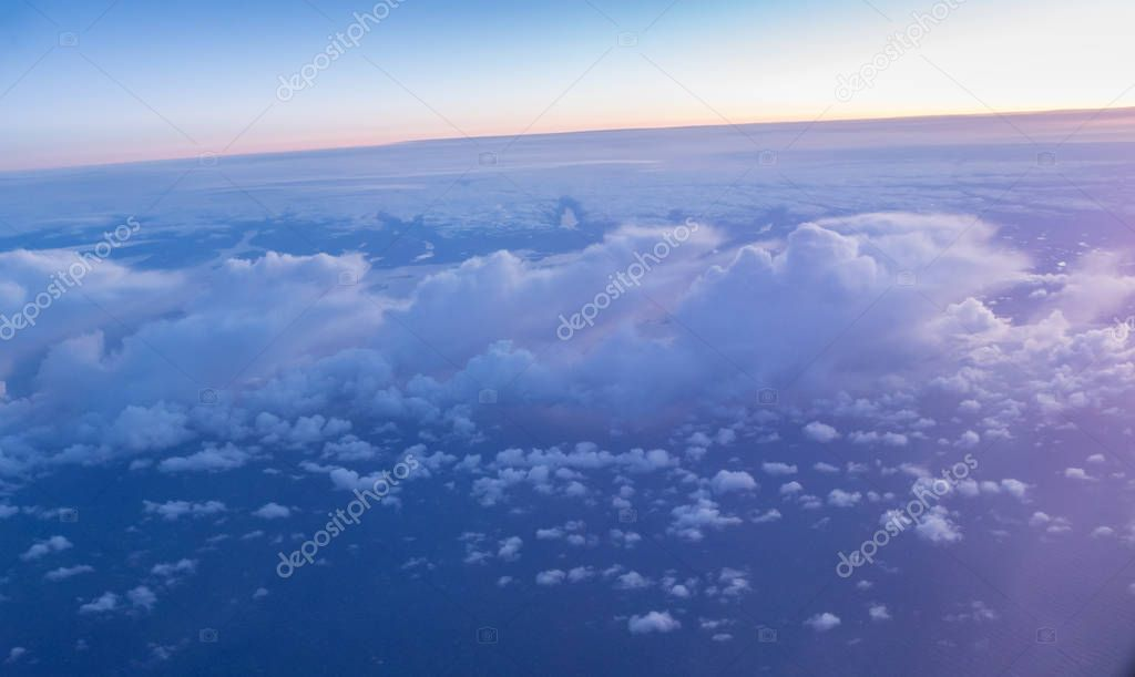 Beautiful sunset with cloudy sky from the airplane window.