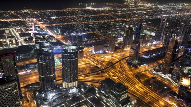 Timelapse of Dubai skyline during night with amazing city center lights and road traffic,United Arab Emirates.