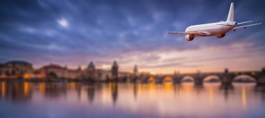 Commercial airplane flying above dramatic clouds during sunset with Charles bridge in background, Prague. stock vector