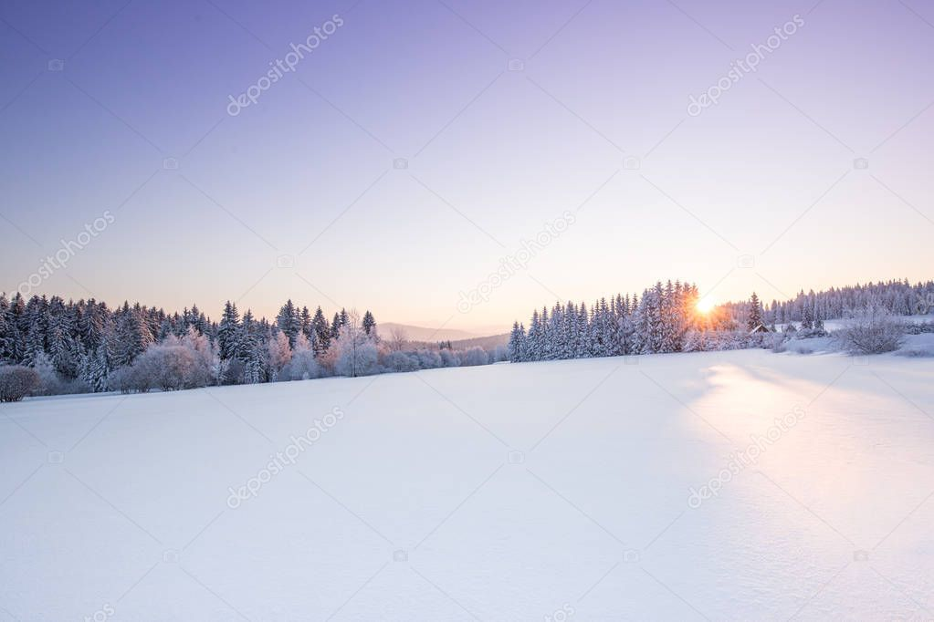 Beautiful winter scenery sunrise in the mountains.