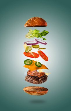 Tasty cheeseburger with flying ingredients on color pastel background. High resolution image. stock vector
