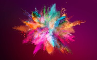 Colored powder explosion on dark gradient background.