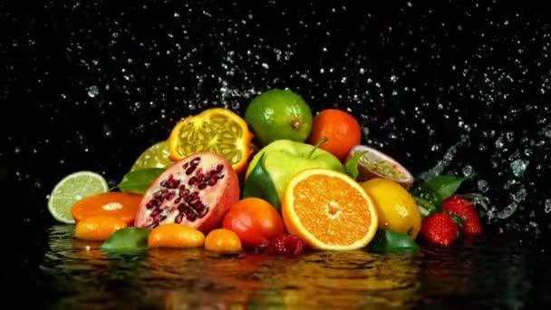 Super Slow Motion Shot of Fresh Fruits with Splashing Water
