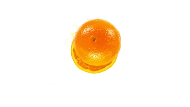 Super Slow Motion Shot of Orange Slices with Splashing Juice Isolated on White Background