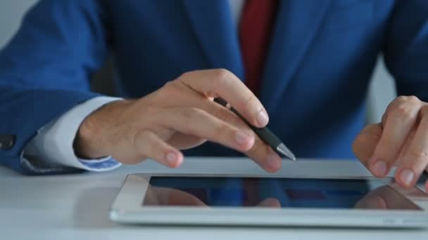 Businessman With Pen In Hand Using Digital Tablet with Business Report. Business And Financial Success Concept. Close Up