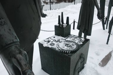 MOSCOW, RUSSIA - Feb 03, 2019: Children are victims of adult vices. Sculptural composition as an allegory of the fight against evil and public vices. Installed on installed on Bolotnaya Square