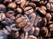 Roasted coffee beans. Food and drink background. Top view.
