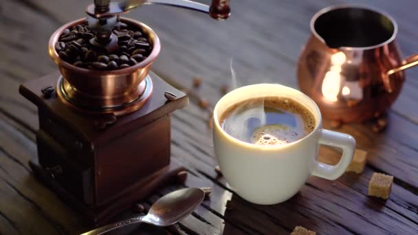 Coffee cup with freshly brewed coffee on an old vintage table. Steam rises from the cup. 4K video.