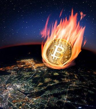 Gece küresinin üzerine düşen yanan bitcoin.