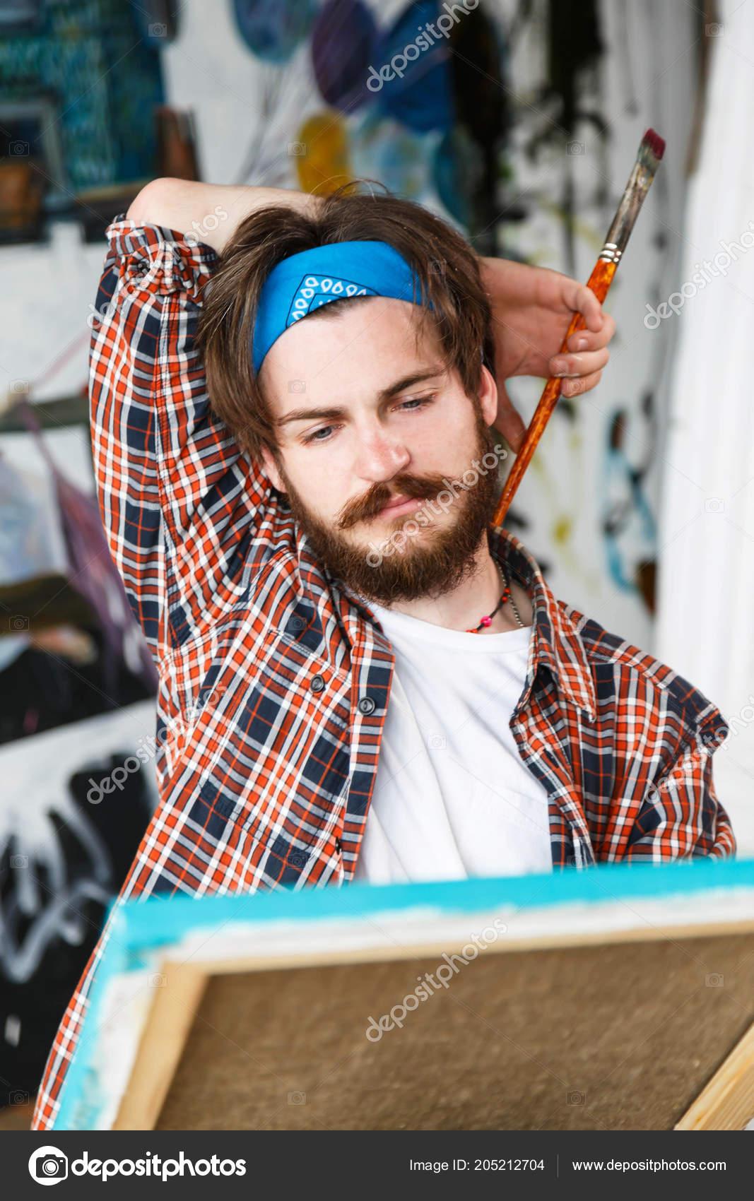 handsome dark haired bearded hipster male artist blue bandana