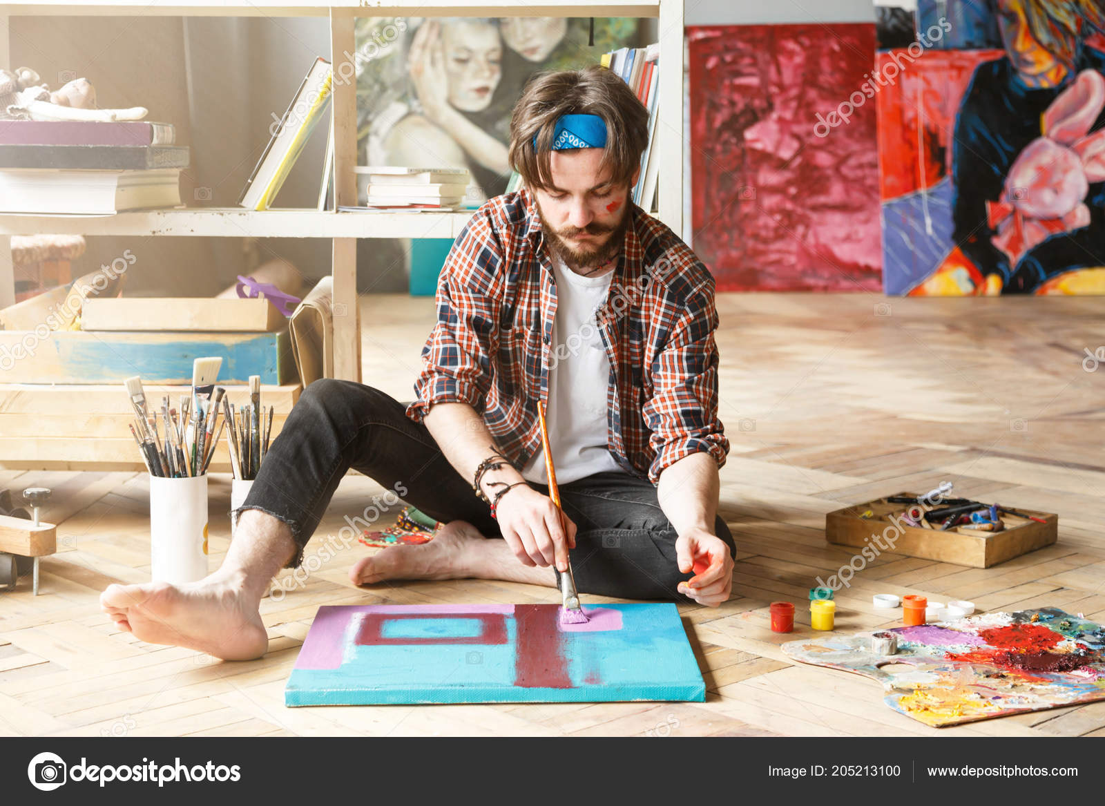 hipster artist drawing in studio stock photo proimagecontent