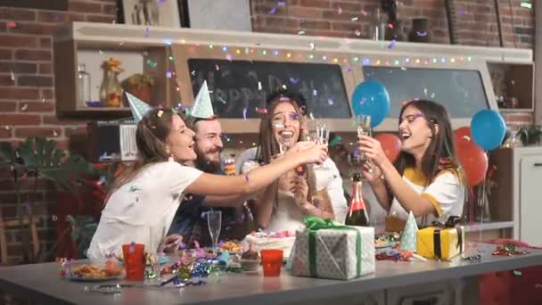 Lifting Glasses in Confetti Shower