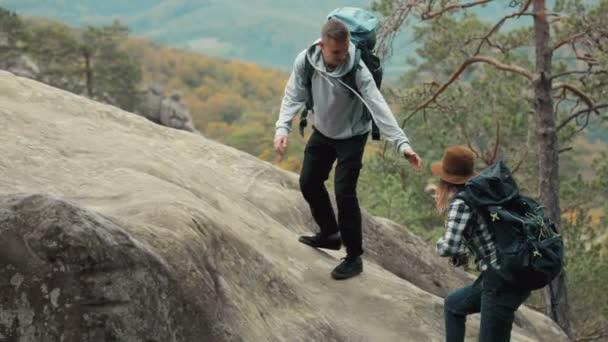 Man Helps Friend to Climb up
