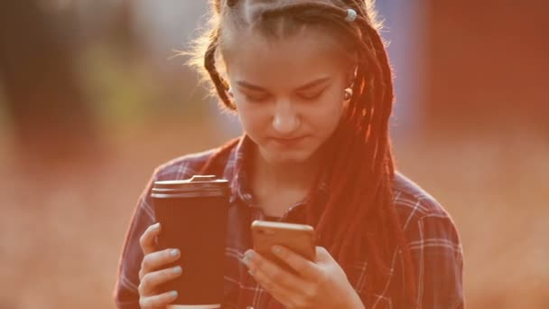 Girl Texts Message in Sunset