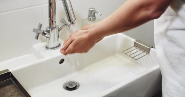 Washing Hands in Washbasin