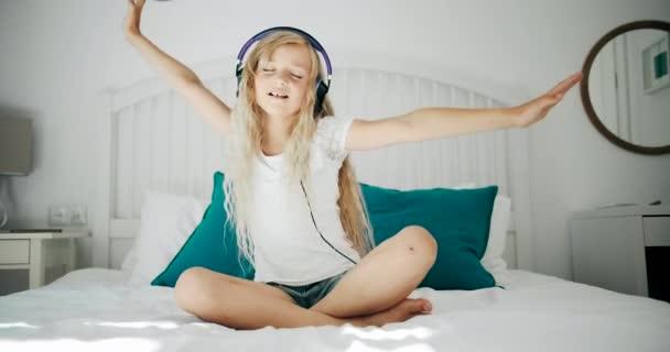 Girl in Headphones in Bed