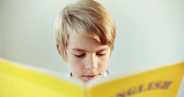 Boy Reading English Book Closeup