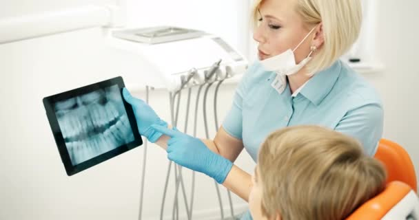Dentist Showing Kid X-ray on Tablet