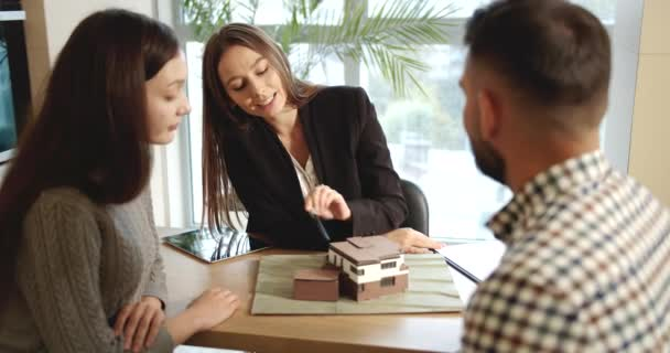 Clients Talking With Real Estate Manager