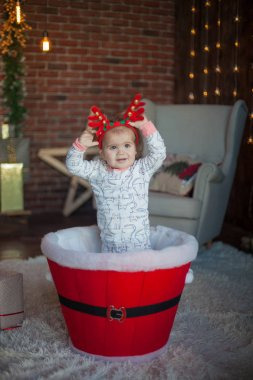 beautiful baby on christmas decorated room