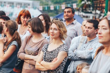 September 1, 2018 Minsk Belarus Street festivities in the evening city A group of people standing on the street.