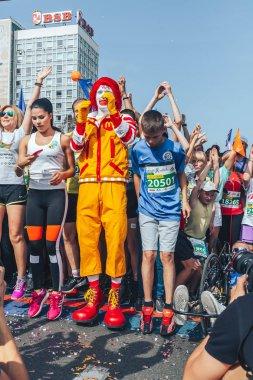 September, 9, 2018 - Minsk, Belarus: Half Marathon, Minsk, group of people doing warm-up on street before start with ronald mcdonald