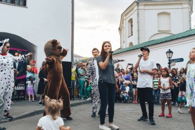 September, 1, 2018 - Minsk, Belarus: Two men with microphones singing on street in front of group of people