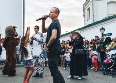 September, 1, 2018 - Minsk, Belarus: man with microphone singing on street in front of group of people