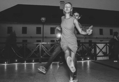 August, 4, 2018 - Minsk, Belarus: black and white shot of Man and woman dancing during event
