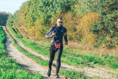 October 6, 2018 - Novogrudok, Belarus, Castle Road: Athletic young man running in nature