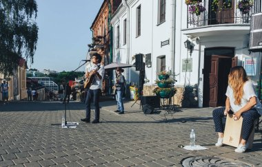July 21, 2018 - Minsk, Belarus: man with guitar sings into microphone on street