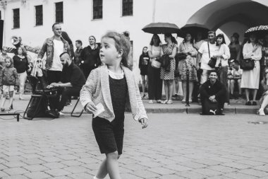 July 21, 2018 - Minsk,Belarus: Street walks. little girl dancing in front of group of people