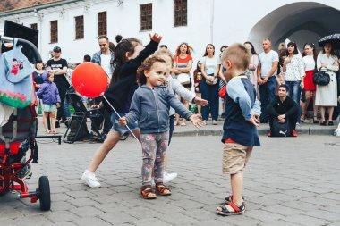 July 21, 2018 - Minsk,Belarus: Street walks. children dancing on square in front of group of people